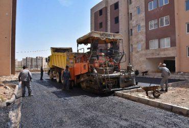 """اجرای محوطه سازی و آسفالت مجتمع مسکونی """"دادگستری"""" و """"مهر 103"""" در شهر جدید گلبهار"""